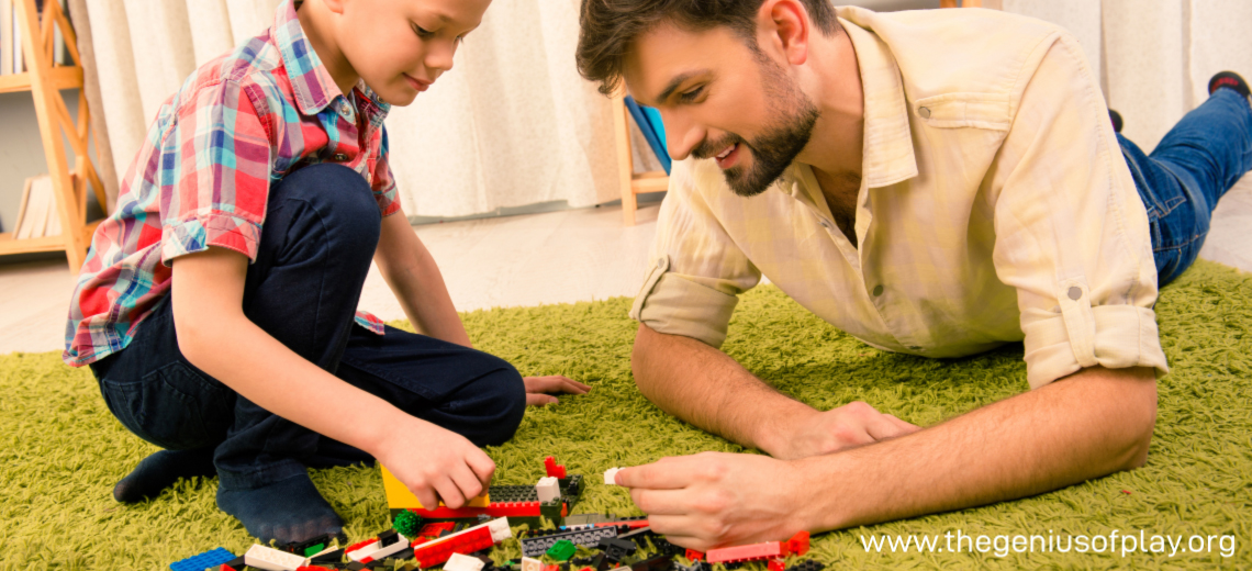 Boy and his dad playing with construction blocks