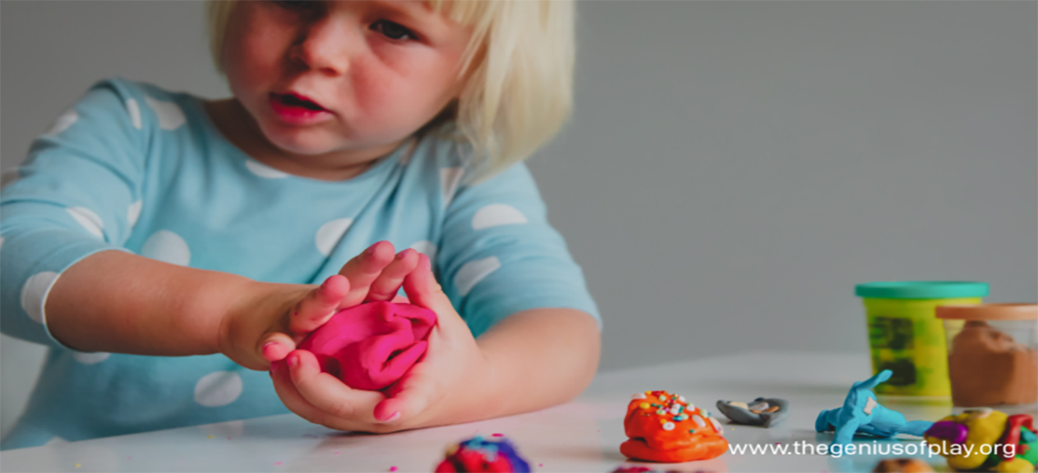 Upset young child playing with molding clay