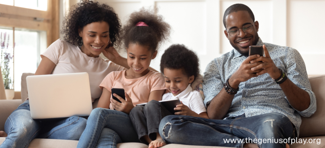 Family with kids relaxing on couch playing on gadgets and screens