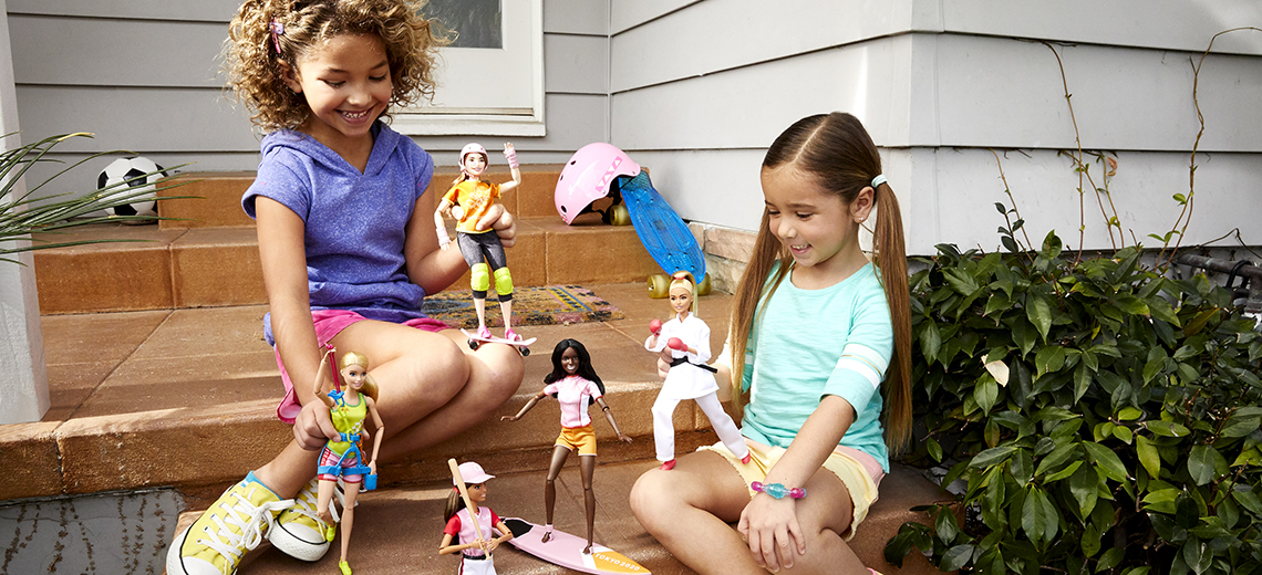 young girls playing with Barbie - image provided by Mattel