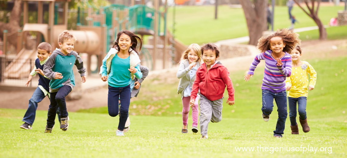 young children running in a playground park