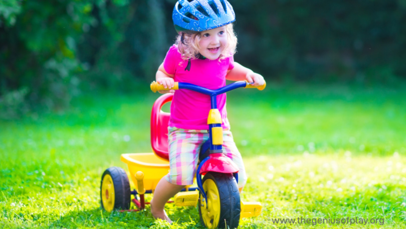 toddler daughter riding a tricycle